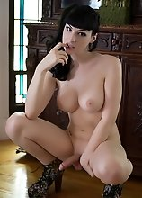 Busty Bailey Jay strips and poses