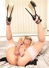 Shemale in glasses fingering in pink nylons